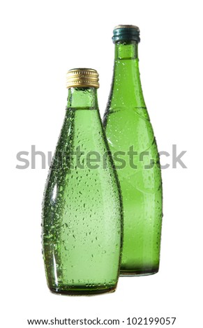 Two Green Glass bottle of soda water. Isolated on white background