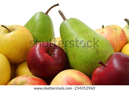 Two green pears and a lot of different apples - stock photo