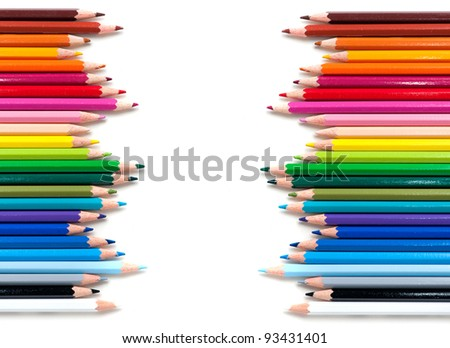two groups of color pencils on white background - stock photo