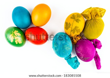 Two groups of Easter eggs, with and without clothes