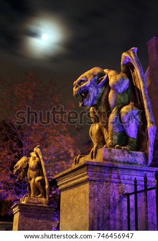Two guardian gargoyles at haunted house