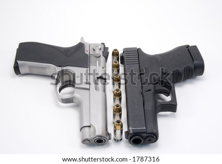 Two guns on white background 9 mm gun and glock 45 with bullets - stock photo
