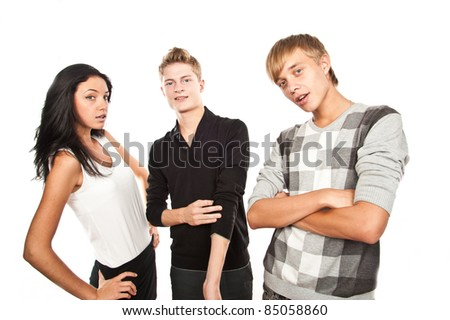 Two guys and a beautiful girl looking into the camera and fool around, isolated over white - stock photo