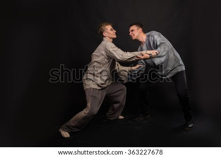 Two guys fighting - stock photo
