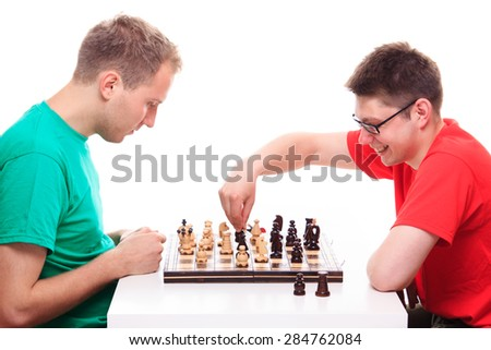 Two guys playing chess  - stock photo