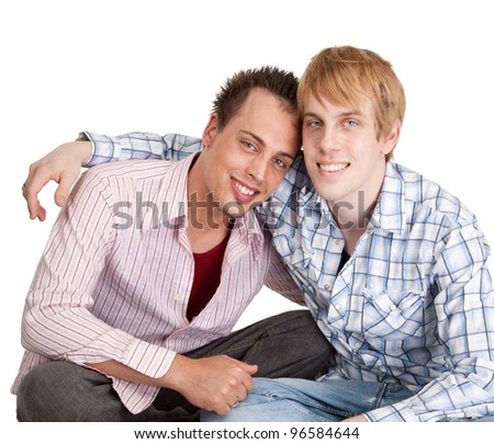 Two guys share a hug and pose for the camera - stock photo