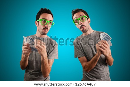 two guys spying poker cards on blue background