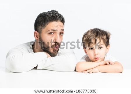 Two guys whistling and staring  to something - stock photo