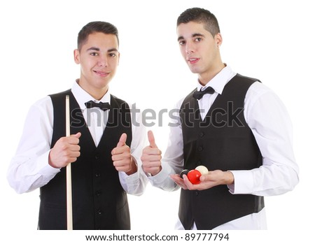 Two guys with snooker balls and a snooker cue smiling