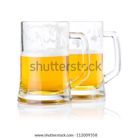 Two half glasses of fresh beer with foam isolated on white background - stock photo