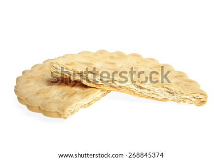 Two half of broken butter biscuits on a white background