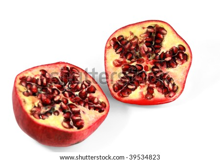 Two half of pomegranate with the grains visible in a cut