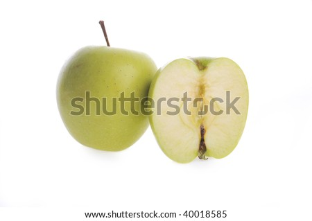 Two half of ripe apple lie on surface