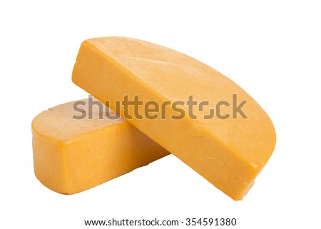two half wheels of colby cheese on a white background
