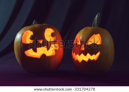 Two Halloween pumpkin scaring each other - stock photo