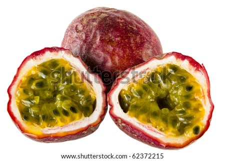 two halves of passion fruit an a whole one - stock photo