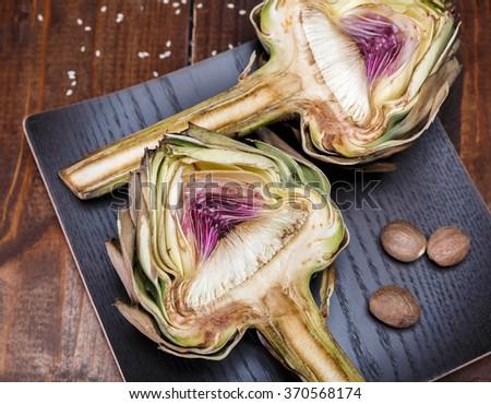 two halves of ripe artichoke - stock photo