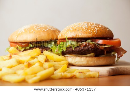 Two hamburgers and french fries