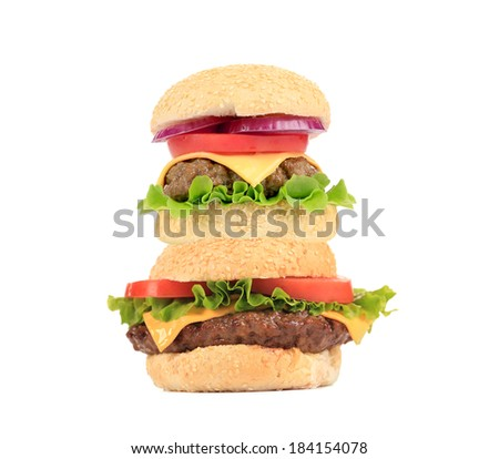 Two hamburgers in stack. Isolated on a white background.