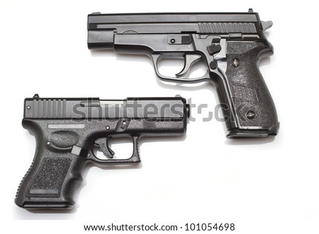 Two hand guns over white background