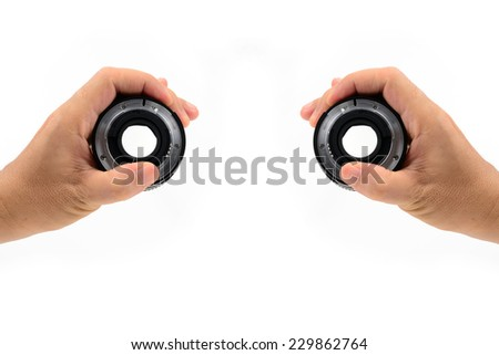 two hand holding DSLR lens isolated on white - stock photo