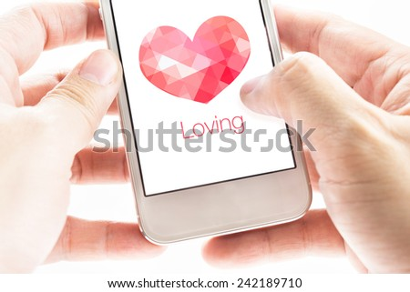 Two hand holding smartphone with pink polygon heart shape and Loving word on screen, Love concept - stock photo