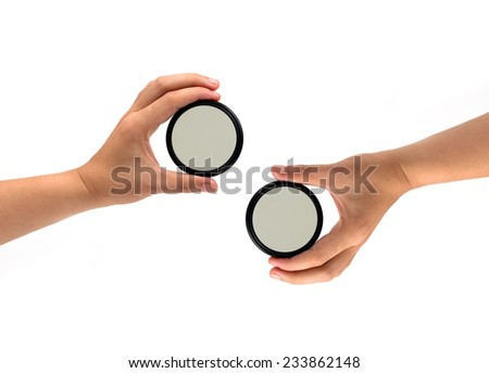 Two hand holds a ND (neutral density) optical filter isolated on white