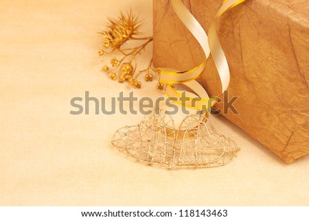 two handmade hearts and gift box on gold background