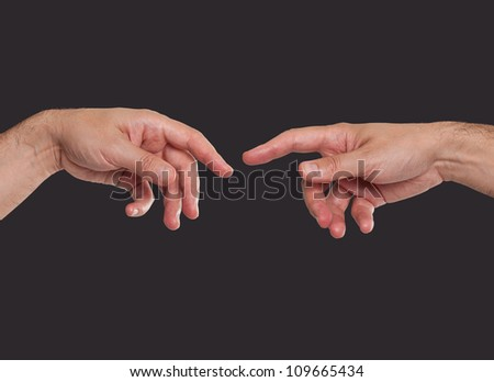 Two hands about to touch - stock photo