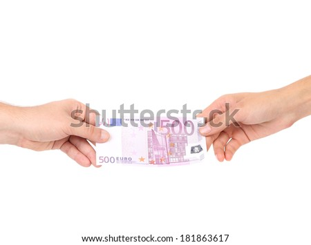 Two hands and 500 euro banknote. Isolated on a white background.
