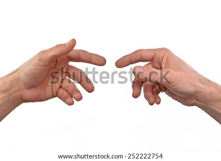 Two hands approaching,touching fingers. - stock photo