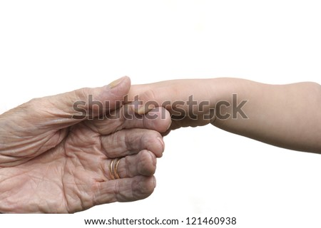 Two hands coming together, five generations away. - stock photo