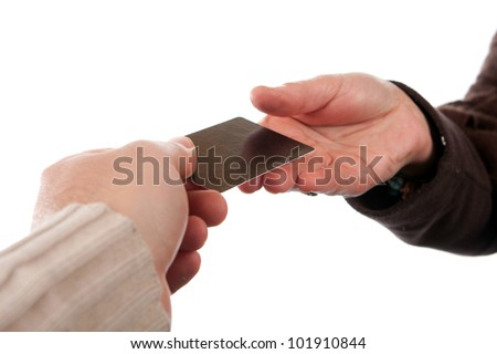 Two hands exchanging a credit debit or gift card isolated over a white background. - stock photo