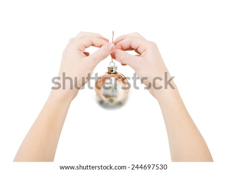 Two hands handing mirror Christmas ball, isolated, clipping path - stock photo