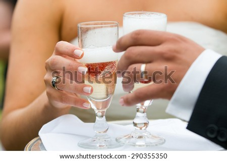 two hands holding a champagne glass - stock photo