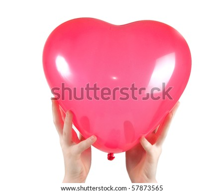 Two hands holding a heart shape balloon on white