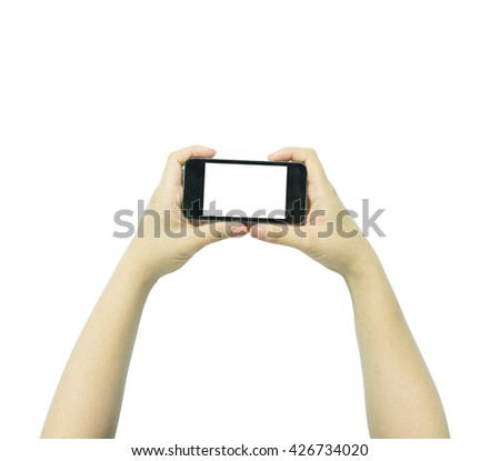 Two hands holding big screen smart phone - stock photo