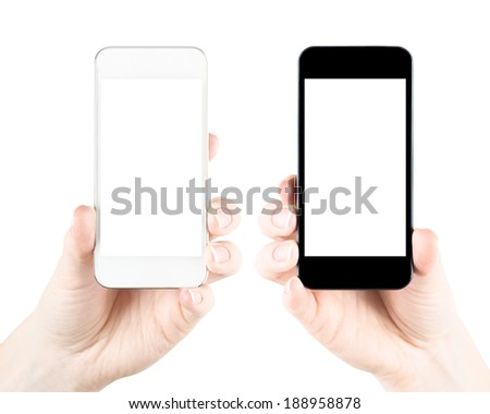 Two hands holding black and white smartphones with blank screen. Isolated on white background - stock photo