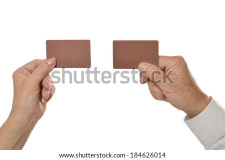 Two hands holding empty blank cards isolated on white background - stock photo