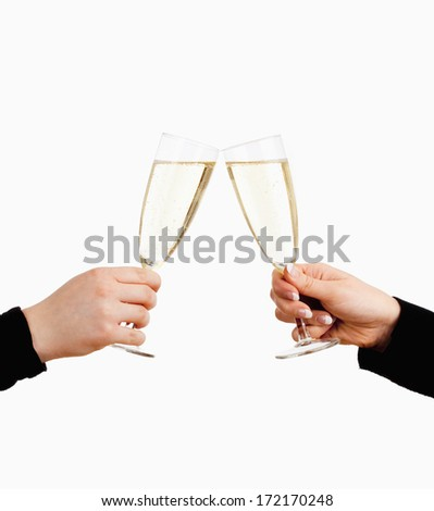 Two Hands Holding Glasses of Champagne Toasting - Isolated on White - stock photo