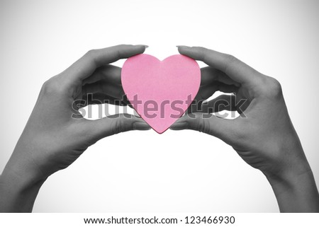 two hands holding red heart symbol concept. isolated on white background - stock photo