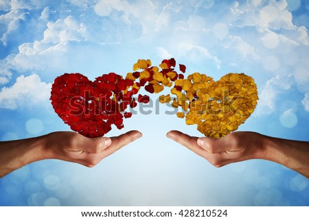 Two hands holding rose petal hearts. Romantic relationship concept. Attachment and love symbol, giving and exchange of feelings and emotions of love. - stock photo
