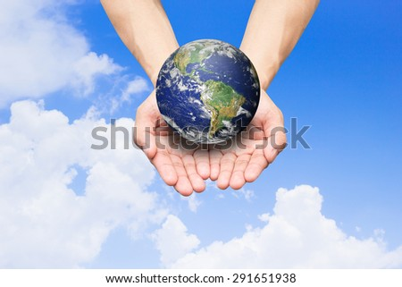Two hands holding the earth on blue sky backgrounds.safe and healing concept :environment and ecology concept.Elements of this image furnished by NASA - stock photo