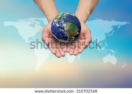 Two hands holding the earth on blurred map over beautiful blue sky backgrounds.safe and healing earth concept.Elements of this image furnished by NASA.safe and healing world concept. - stock photo