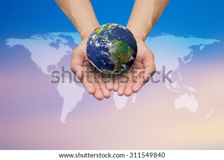 Two hands holding the earth on blurred map over beautiful twilight sky backgrounds.Elements of this image furnished by NASA.safe and healing world concept. - stock photo