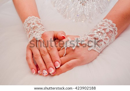 Two hands in lace gloves with beautiful nails.