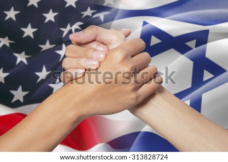 Two hands in partnership hand poses with the american and israel flags