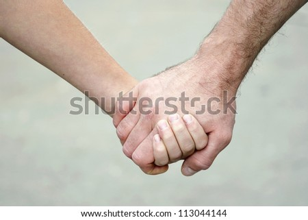 two hands keeping together - stock photo