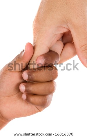 Two hands of different races together on a white background - stock photo