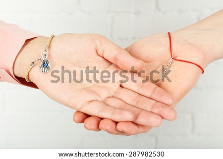 Two hands of friendship and religions symbols - stock photo